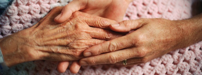 Holding Hands with Elderly Patient --- Image by © Wernher Krutein/Corbis